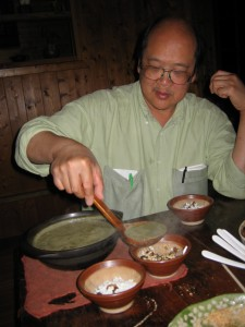 Ladle tea into bowls, add sweet condiments and puffed rice to taste.
