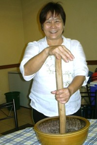 Amy Wong shows the bowl and stick she uses to make pounded tea.