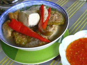 Singapore stuffed tofu, chiles, and bitter melon in broth